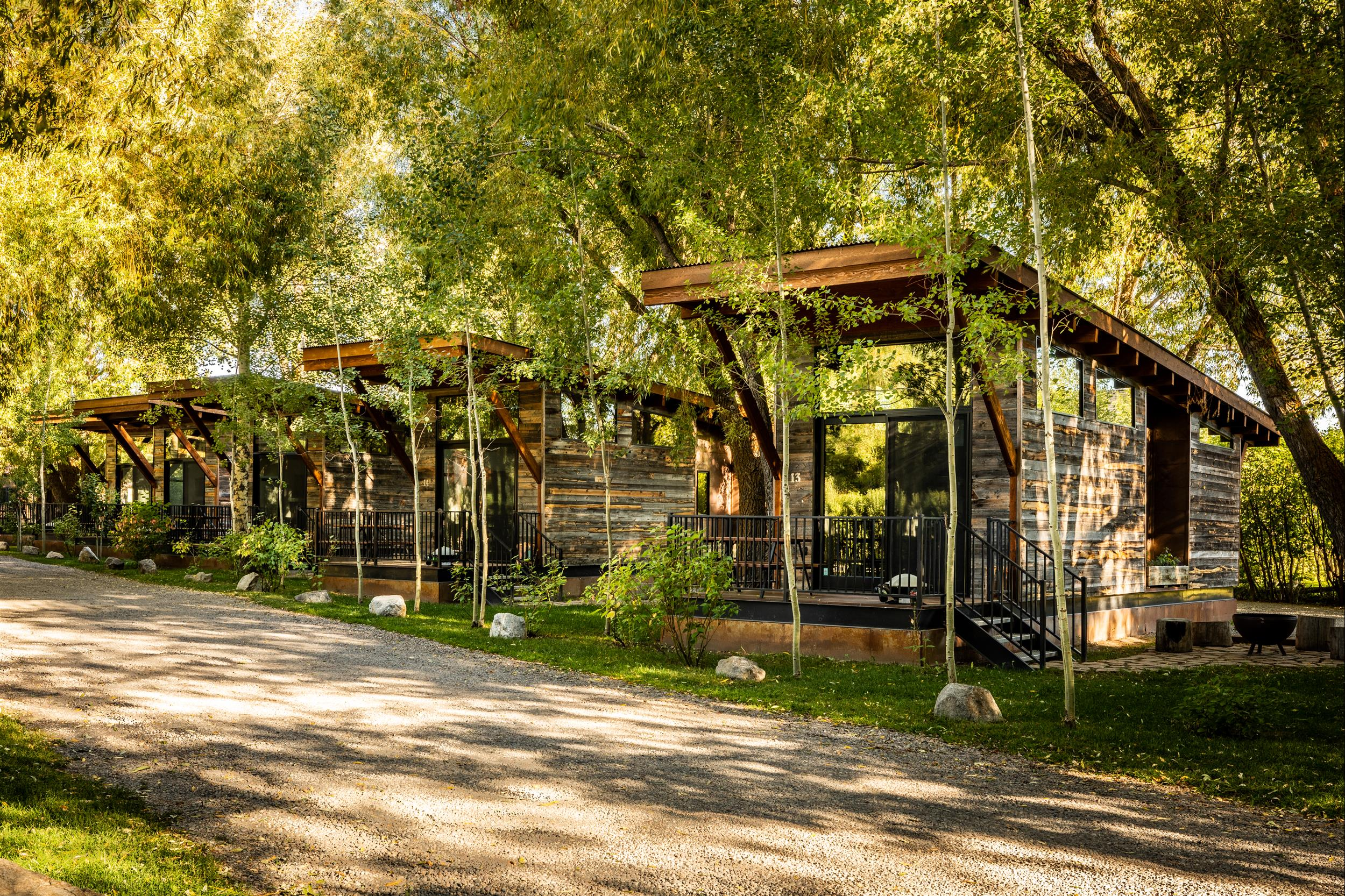 row of modern rustic chic cabins at Fireside Resort in Jackson Hole wyoming